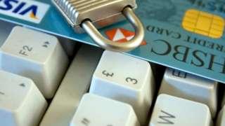 A computer keyboard, credit card and padlock