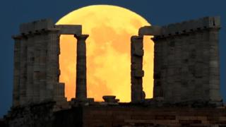 The Moon rises behind the Temple of Poseidon in Cape Sounion, near Athens