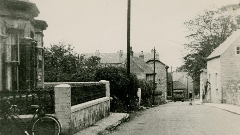 A historical photograph of Church Street, Wales, South Yorkshire