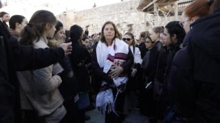 """Anat Hoffman (C), the head of the liberal Jewish religious movement """"Women of the Wall"""", leaves Judaism's holiest prayer site of the Western Wall in the Old City of Jerusalem on 8 March 2019"""