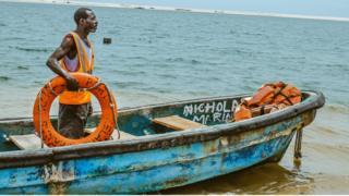 Lifeguard Nicholas Paul on his boat