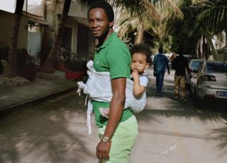 Cheikh and Zoe in Point E, a central neighbourhood in Dakar, Senegal