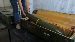 A picture taken in Tripoli on June 29, 2019, shows fighters loyal to the internationally-recognised Libyan Government of National Accord (GNA) displaying precision guided munition, which were reportedly confiscated from forces loyal to General Khalifa Haftar in Gharyan.