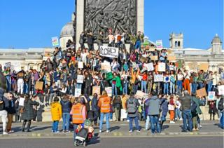 Protesters gather on the steps of Nelson's Column in Trafalgar Square