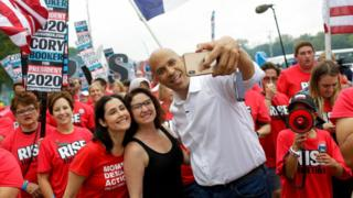 Cory Booker taking a selfie at the Polk County Steak Fry