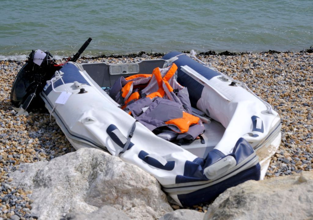 A boat used by migrants on the shore at Kingsdown Beach August 31, 2019 in Dover, England